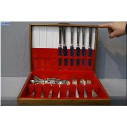 A wooden canteen containing flatware setting for six of Rogers silver plate including dinner knives,