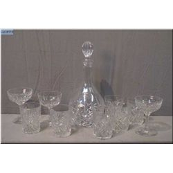 A crystal decanter and stopper, six pinwheel crystal tumblers and a set of champagne glasses etc