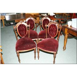 Four antique Victorian dining chairs with tapered front supports, decorative carved back and button