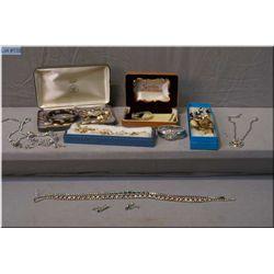 A selection of vintage costume jewellery including enamelled bracelet, rhinestone earrings, necklace