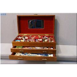 A wood two drawer jewellery box and contents including rhinestone brooches, necklaces and  earrings,
