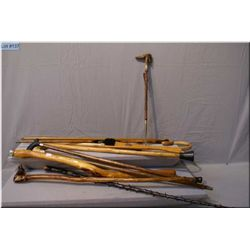 Nine walking sticks and two shoe horns, all vintage and made from wood