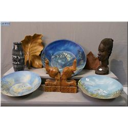 A selection of collectibles including wooden African bust, a pair of carved wooden elephant  bookend