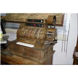 Huge four drawer National cash register. Note: Drawer section is all oak and top is metal simulated