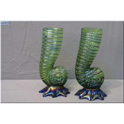 A pair of vintage snail shell glass vases with cobalt iridescent bases, note distress to base of one