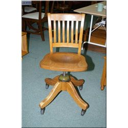 A vintage quarter cut oak steno chair