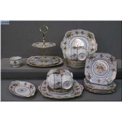 A selection of Royal Albert Petit Point china including eight cups and saucers, open sugar, cake sta