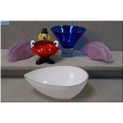 A selection of art glass including a pair of Murano glass napkin/letter holders, a clown dish and a