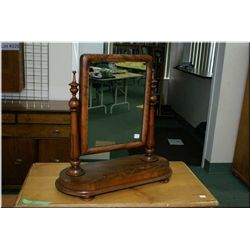 A Victorian mahogany dresser top vanity mirror on bun feet