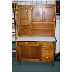 Antique oak kitchen cabinet made by The Barnet Kitchen Beautiful Refrigerator Company with roll up s