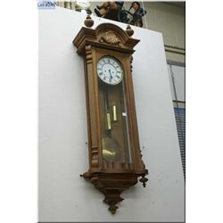 Wall hanging clock with pendulum and glass case