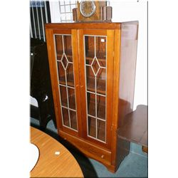 A mid 20th century country kitchen style book cabinet with two leaded panels
