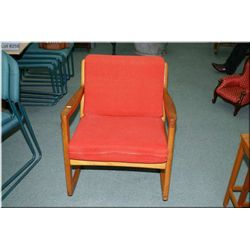 A Danish teak France & Sons rocking chair and armchair