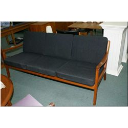 A Danish teak France & Sons three seat sofa