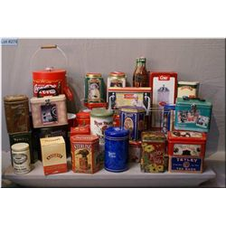 Large selection of tins including tea, cocoa cola etc.