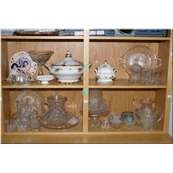 A large selection of vintage glassware and crystal including cake stand, pitchers, fruit bowl, cruet