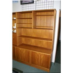 A teak wall unit with display shelf and lockable cupboard sections, matches lot 281