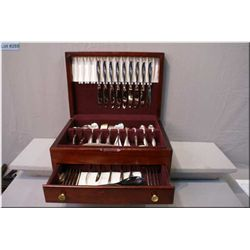"A wooden canteen containing settings for nine of Rogers Bros. ""Daffodil"" flatware including dinner f"