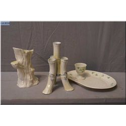 A selection of Irish Belleek including black mark four branch vase, a green mark tree trunk vase and