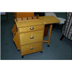 Teak end table with door and a modern multi drawer wheeled cart