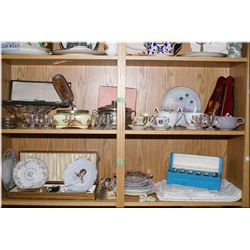 A large selection of collectibles including table linens, boxed horn carving set, vintage plates,  g