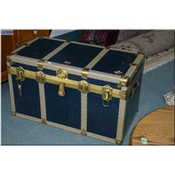 Vintage blue steamer trunk with metal binding and hardware