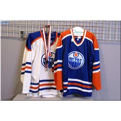 Two signed Oiler's Craig Simpson jerseys and two lanyards