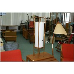 A mid 20th century teak sculptural table lamp