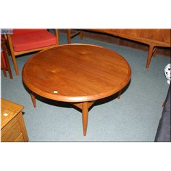 Round teak coffee table with reversible top