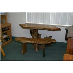 A handcrafted burl wood desk and bench