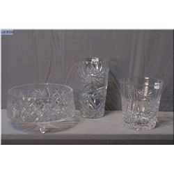 Three pieces of pinwheel crystal including footed bowl, vase and ice-bucket