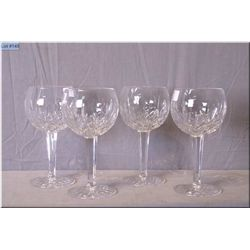 Four signed Waterford crystal wine goblets