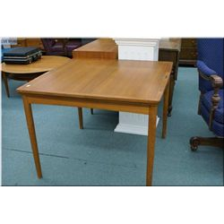 """A Danish teak 36"""" square table with two extending  leaves"""