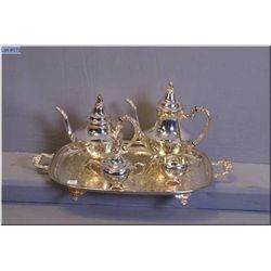A Rogers Bros. silver plate tea service including footed tray, coffee and tea pots and lidded sugar