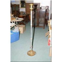 A vintage brass and mercury glass floor lamp