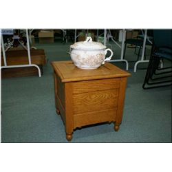 """An antique oak commode with a """"Ridgewood and Son"""" England lidded chamber pot"""