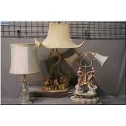 A selection of lamps including oriental motif figural lamp with pagoda shade, cherub motif table  la