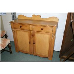 A vintage two drawer, two door pine sideboard