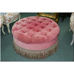 A vintage button tufted  upholstered ottoman 3 feet in diameter