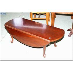 A cherry Gibbard drop leaf coffee table on cabriole feet