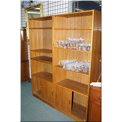 A pair of teak book cases with double sliding door under storage