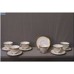 "Six Doulton ""Royal Gold"" teacups and saucers"