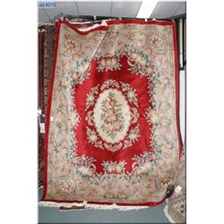 "Large sculpted wool area rug with red background and floral medallion and wide border. 96"" x 124"""