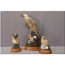 "Three hand carved Buffalo horn statues including two owls and an eagle 13 1/2"" in height"