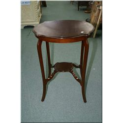 A round occasional table with small under shelf