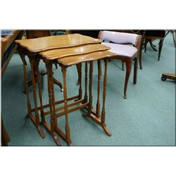 A set of three delicate walnut nesting tables