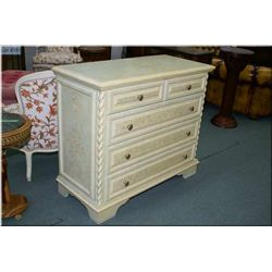 A hand painted five drawer dresser