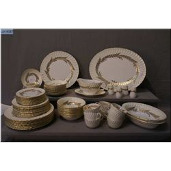 A Minton dinner service for nine including dinner  plates, side plates, bread and butter plus cups