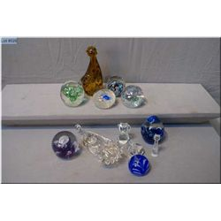 A selection of case glass paperweights and other whimsies, some vintage