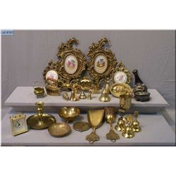 A large selection of modern and vintage brass including picture frame, bells, carriage, iron, horses